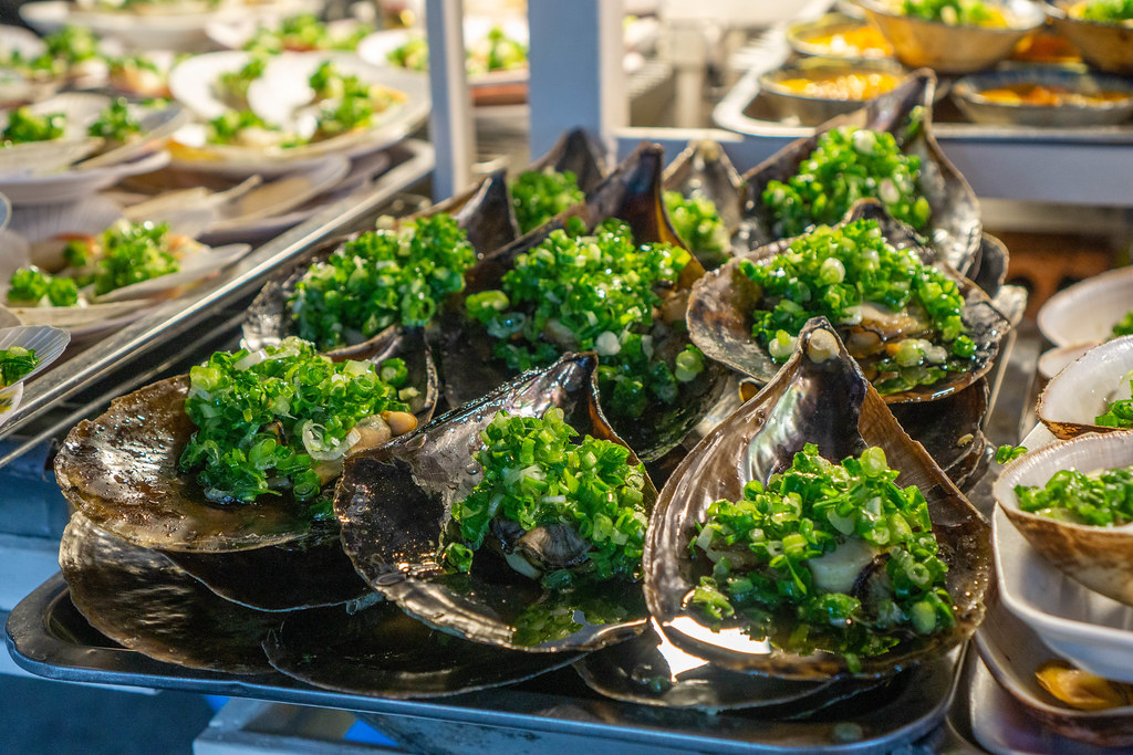 Close Up Photo of Grilled Horn Scallops with Spring Onions on a Street Food Cart at the Night Market in Phu Quoc, Vietnam