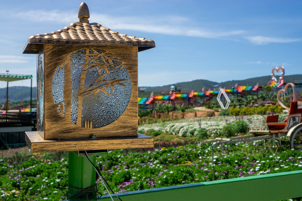 Close Up Photo of Wooden Electric Lantern with Flower Garden in the Background at Me Linh Coffee Garden in Dalat, Vietnam