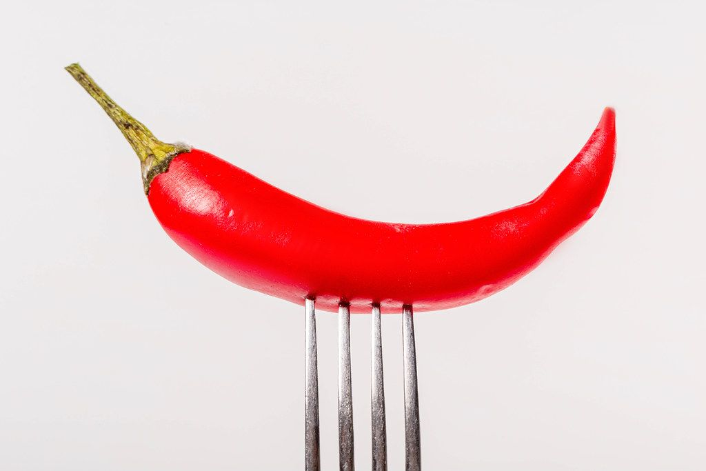 Close-up, red hot chili pepper on a fork