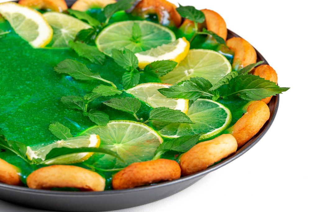 Close-up, slices of lime, lemon with mint leaves on a pie