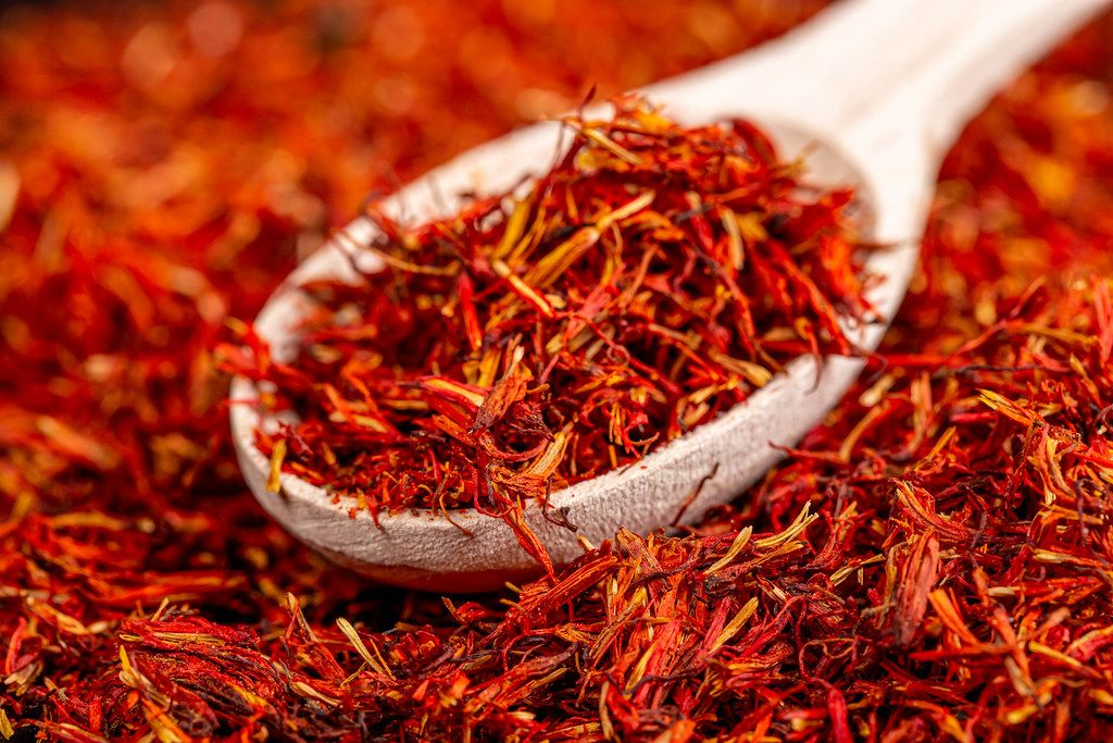Close-up, spice saffron with wooden spoon