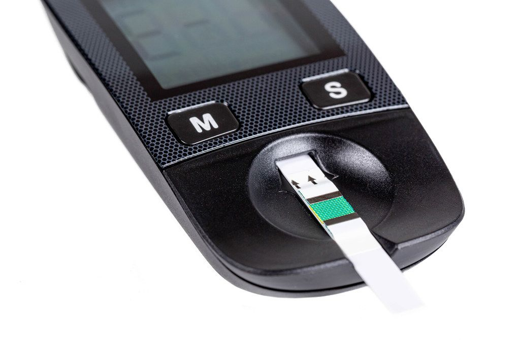 Close-up, test strip in a glucometer