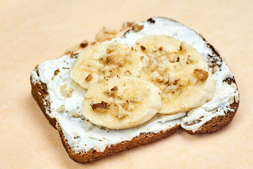 Close-up view of sliced banana with walnut
