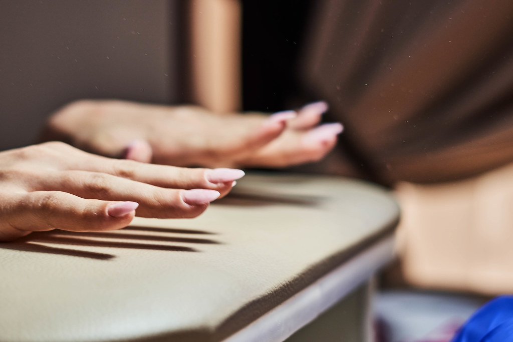 Close-up view of young woman hands after professional manicure in beauty salon