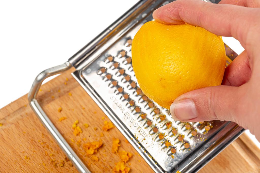 Close-up, women grating lemon zest