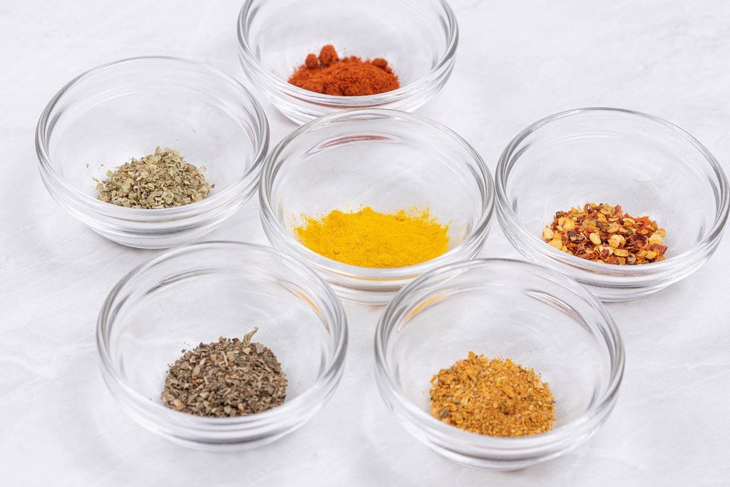 Closeup image of Kitchen Spices in the glass bowls