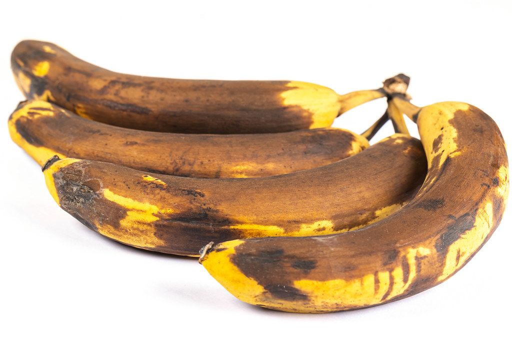 Closeup of overripe old bananas on white