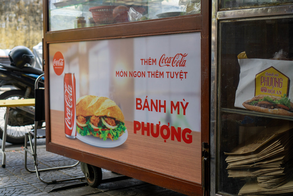 Coca Cola Advertisement on a Food Cart at famous Banh Mi Phuong Restaurant in Hoi An, Vietnam