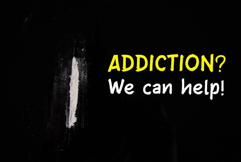 Cocaine powder in line with Addiction We can help text