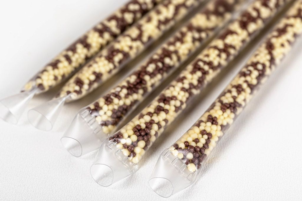 Cocktail tubes with chocolate and banana filling inside