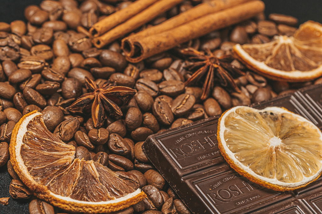 Coffee beans, dark chocolate and winter spices background