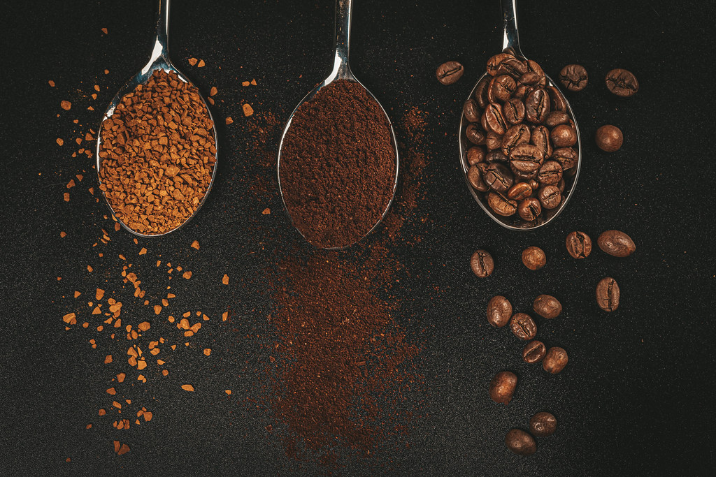 Coffee variation - powdered, instant coffee and beans in spoons