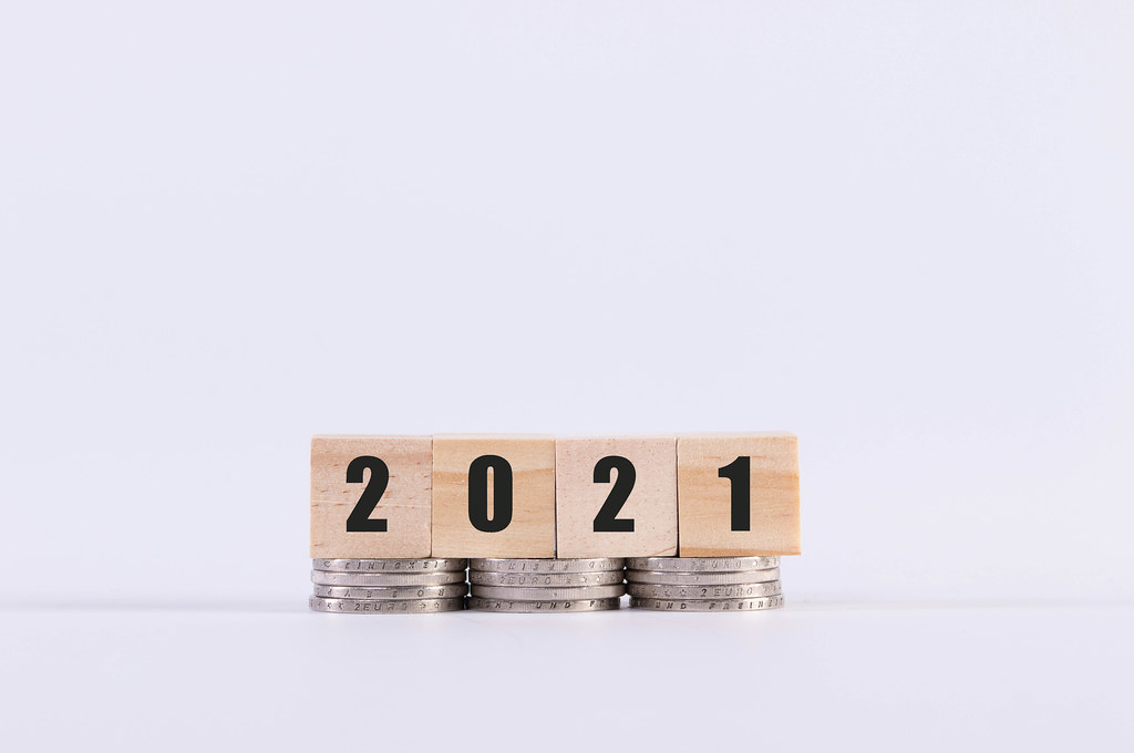 Coins and wooden cubes with 2021 text