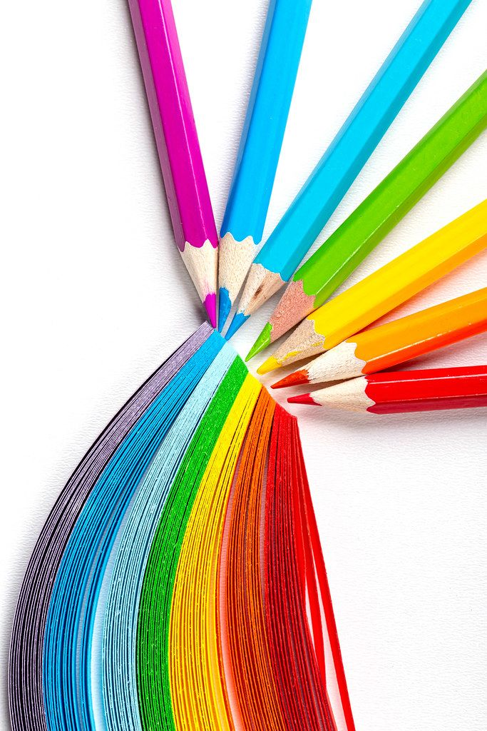 Colored pencils and rainbow made of colored paper