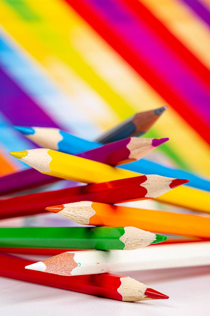 Colored pencils on a colorful background