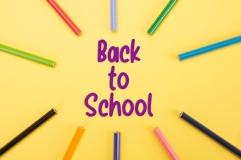 Colored pencils with Back to School text on yellow backgorund