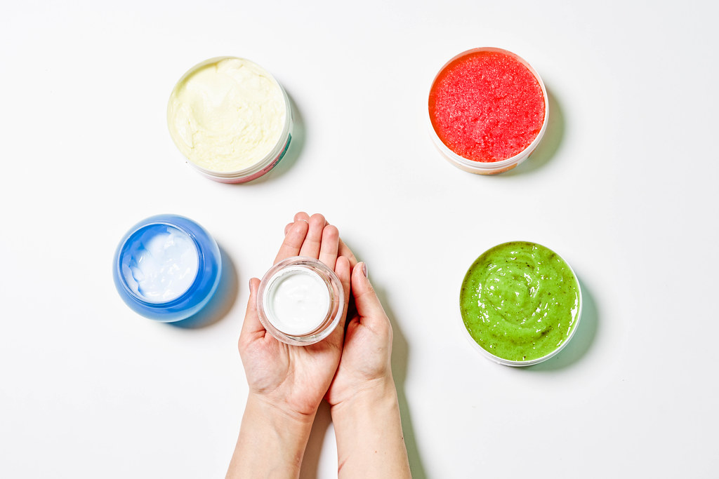 Colorful cosmetic creams containers made with herbs