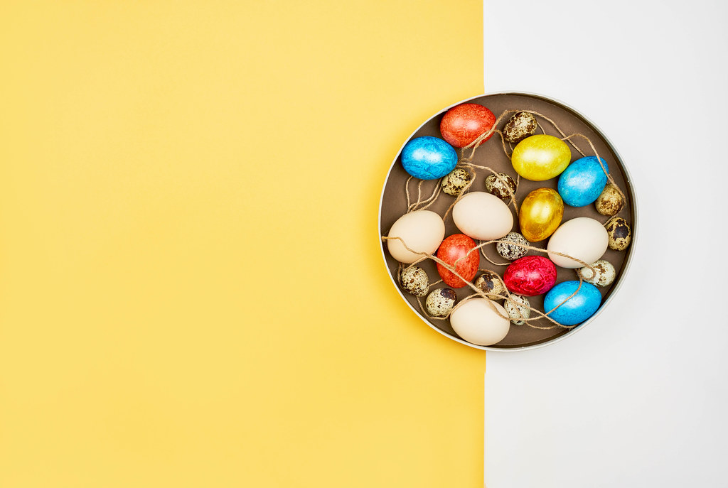 Colorful Easter eggs on bright split background