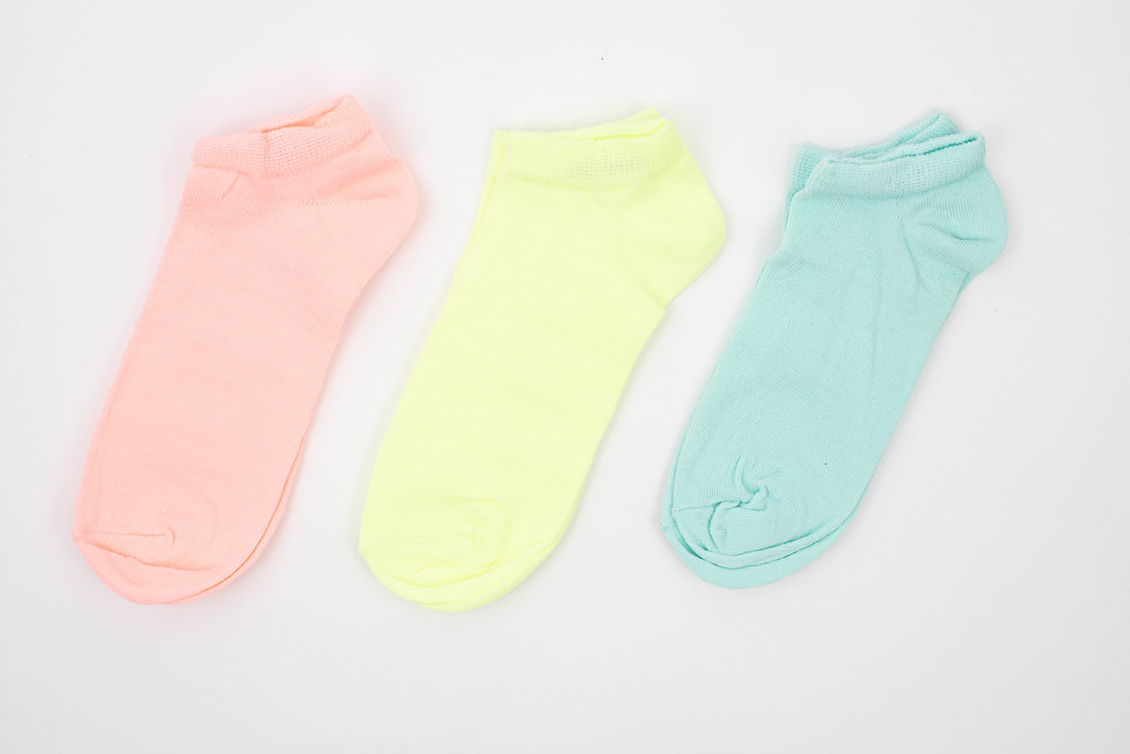 Colorful Kids Socks above white background
