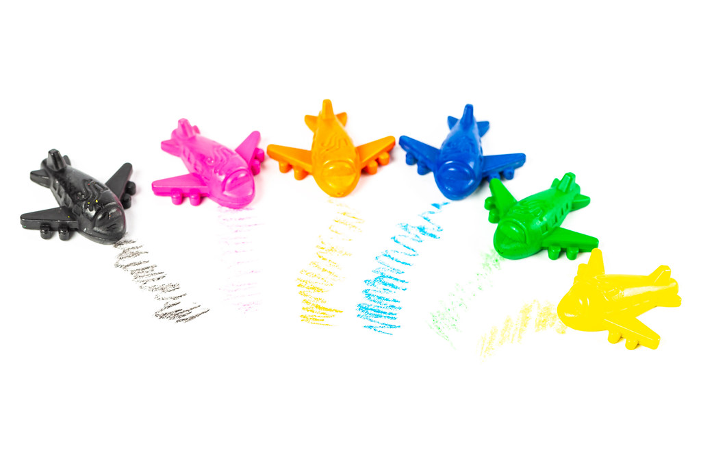 Colorful set of crayons airplanes on a white background
