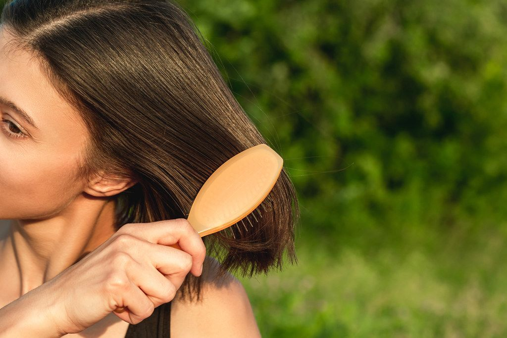 Comb on women's hair, close-up