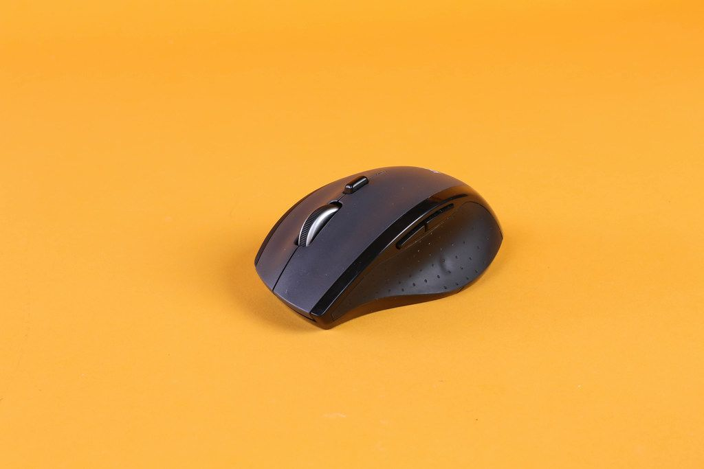 Computer mouse on orange background