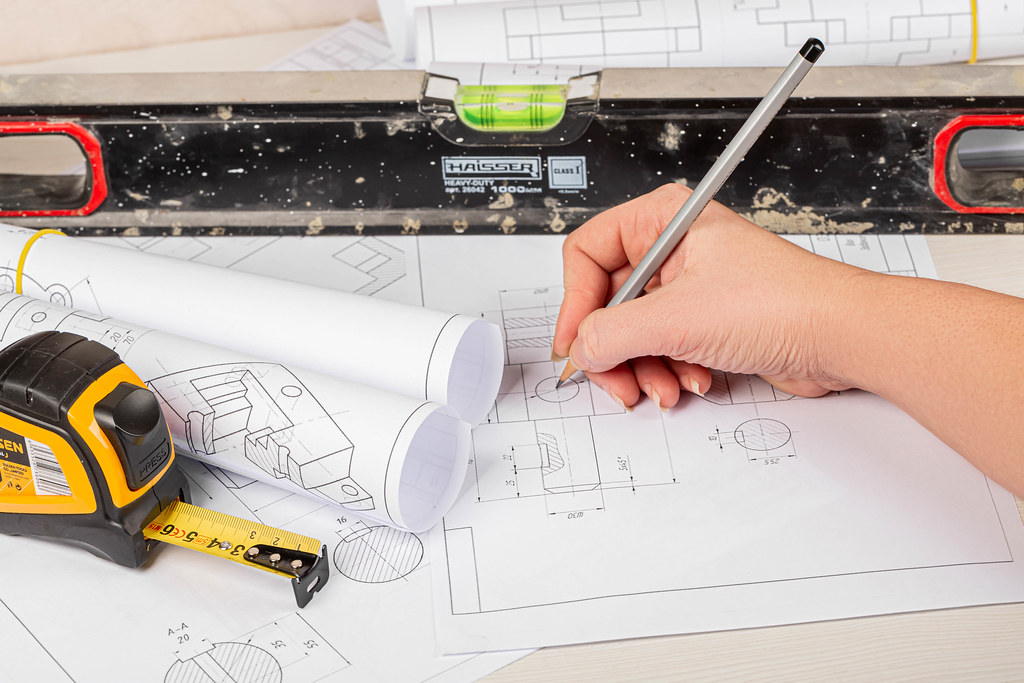 Concept engineer work, holding pencil while working with drawings