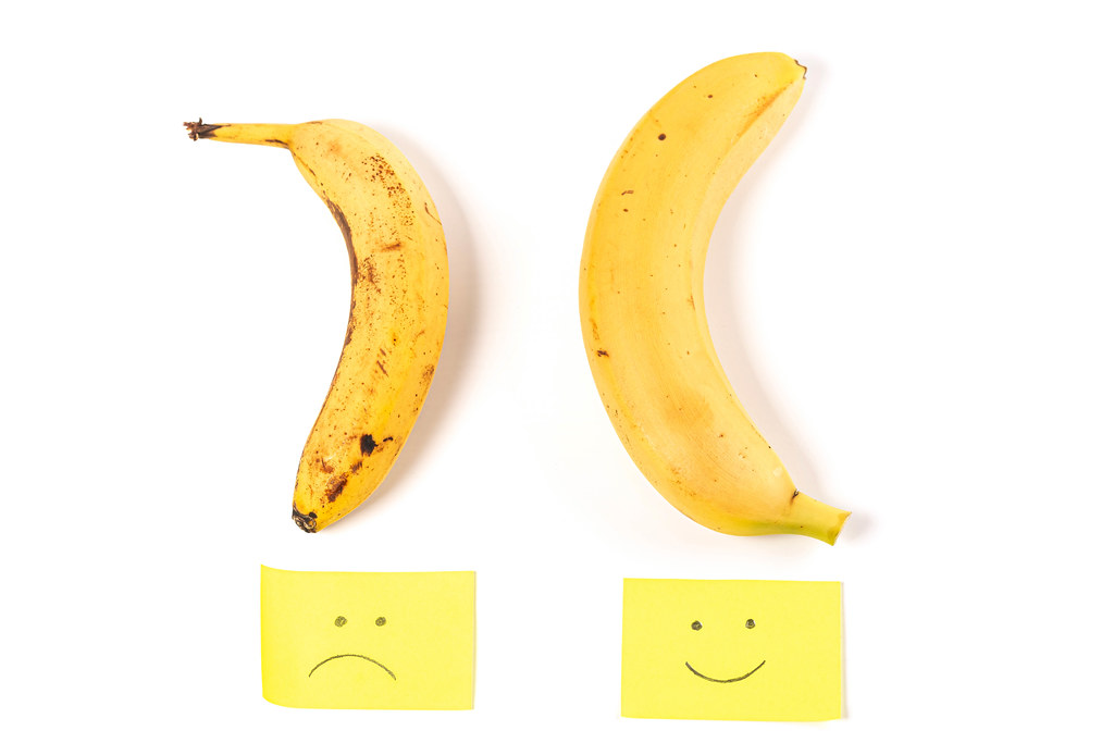 Concept of potency, smiley and sad faces with two bananas up and down