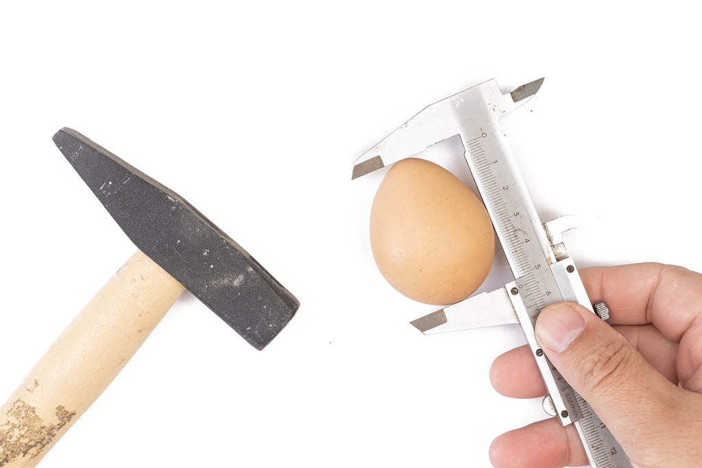 Concept of tools with food and measuring egg with caliper