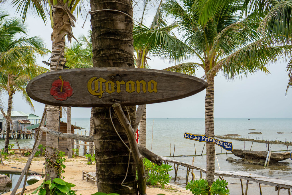 Corona Beer Wooden Signboard on a Palm Tree at Rory