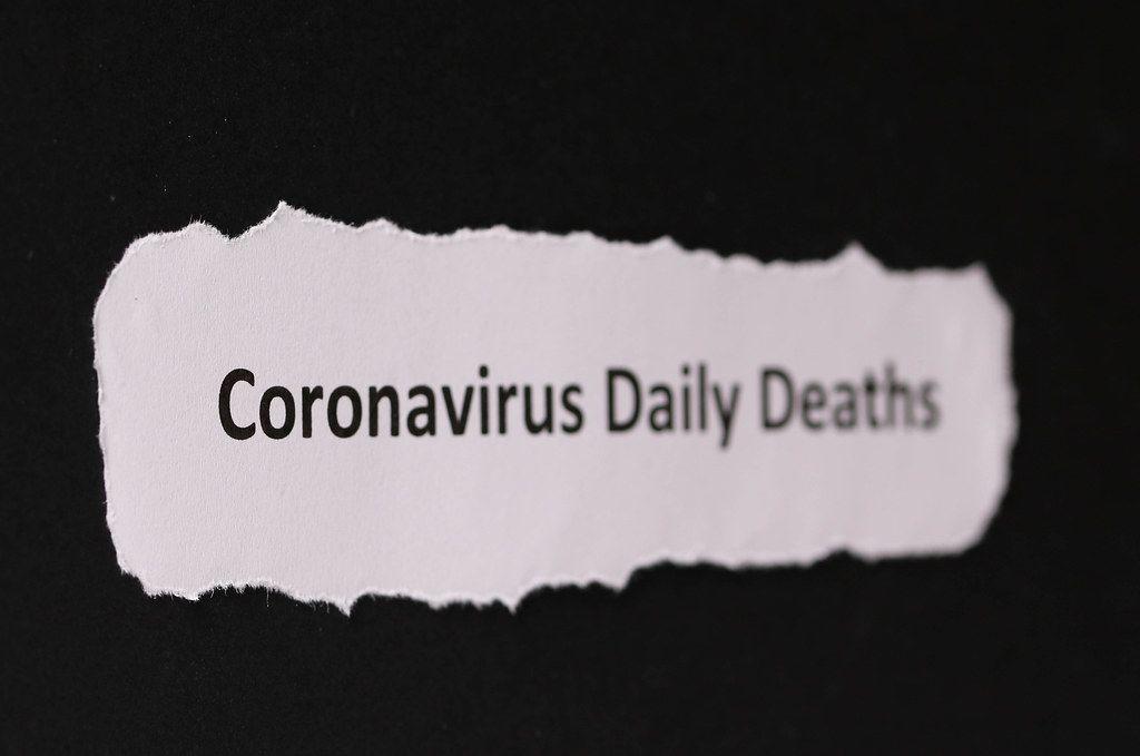 Coronavirus Daily Deaths text on black background