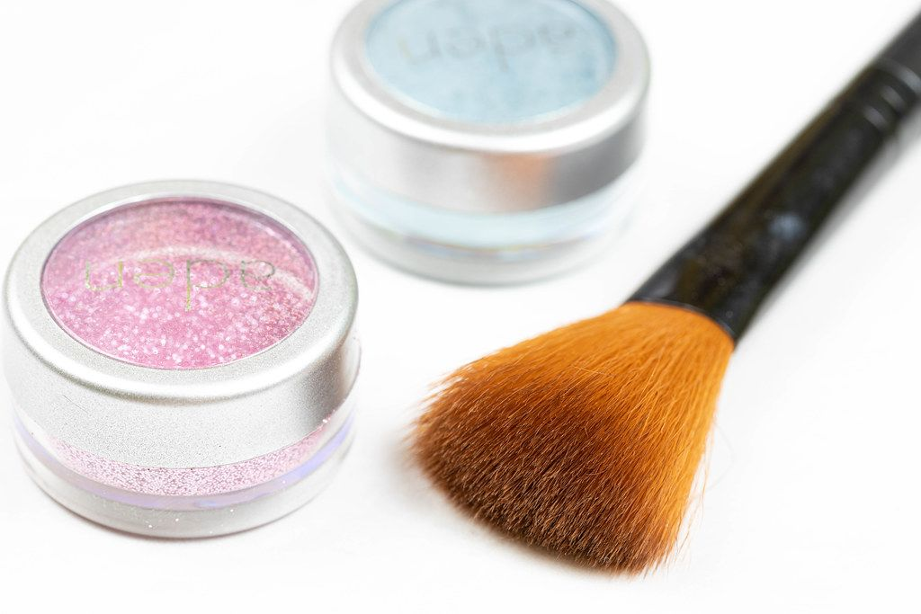 Cosmetics Brush with Glitters in the box above white background table