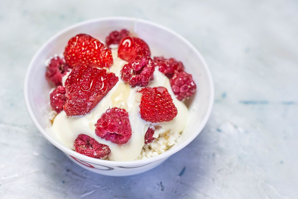 Cottage cheese and yogurt mix with strawberry and raspberry