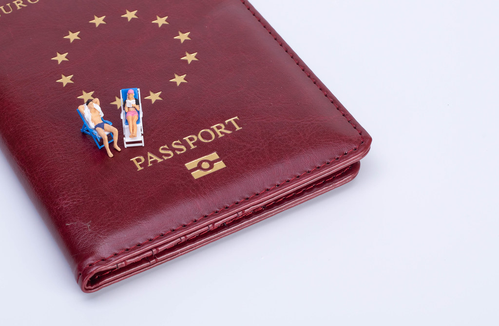 Couple sitting in deck chairs on top of the passport