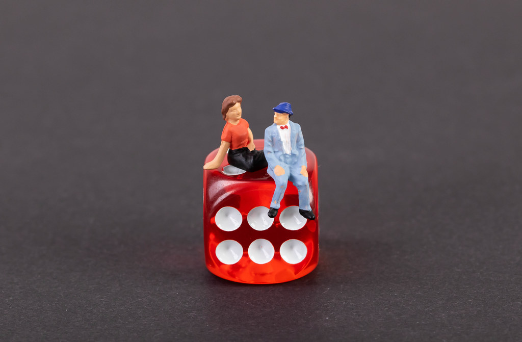 Couple sitting on a dice