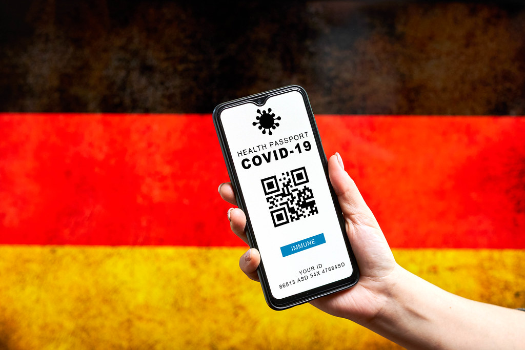 COVID-19 health passport app against Germany flag
