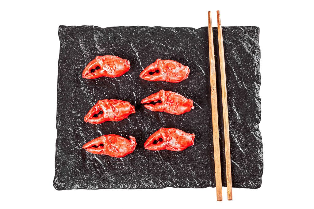 Crab claws on a black stone tray, top view