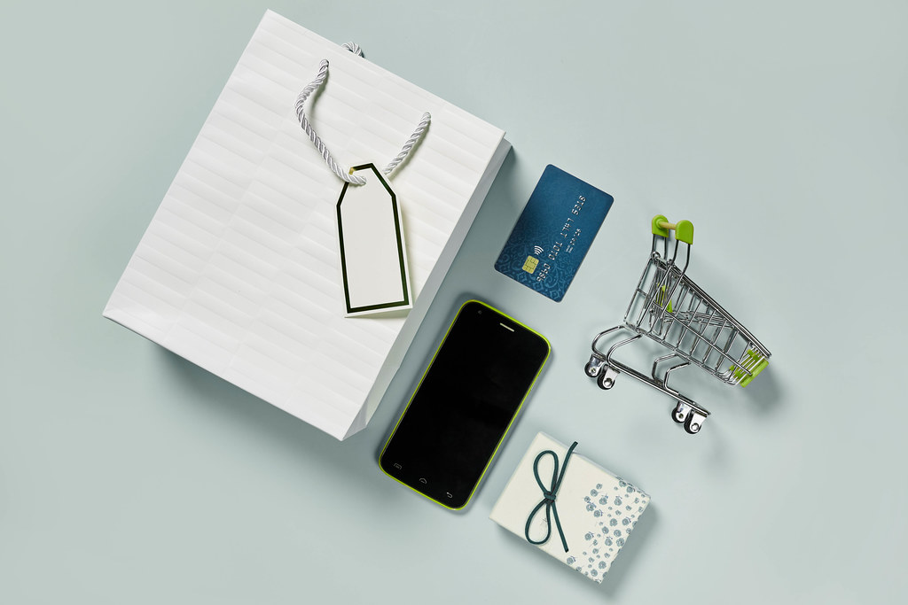 Creative flat lay - online shopping background on pastel color backdrop