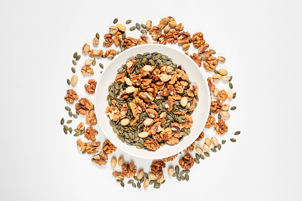 Creative variety of nuts on white background