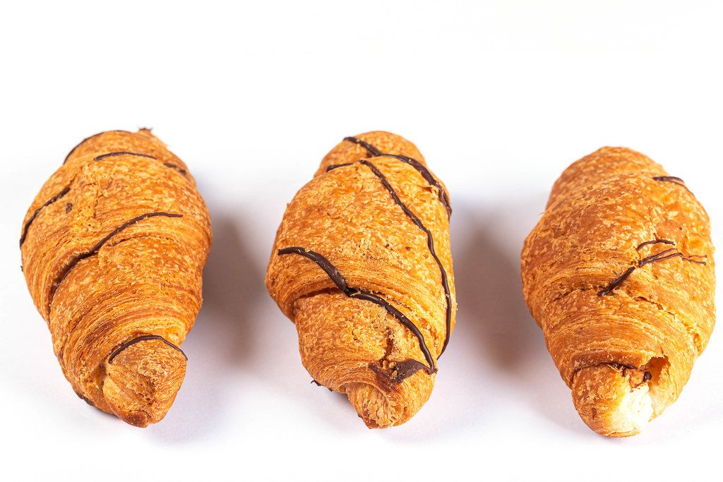 Croissants with chocolate on a white background