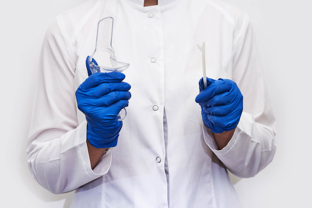 Cropped shot of gynecologist holding gynecology instruments