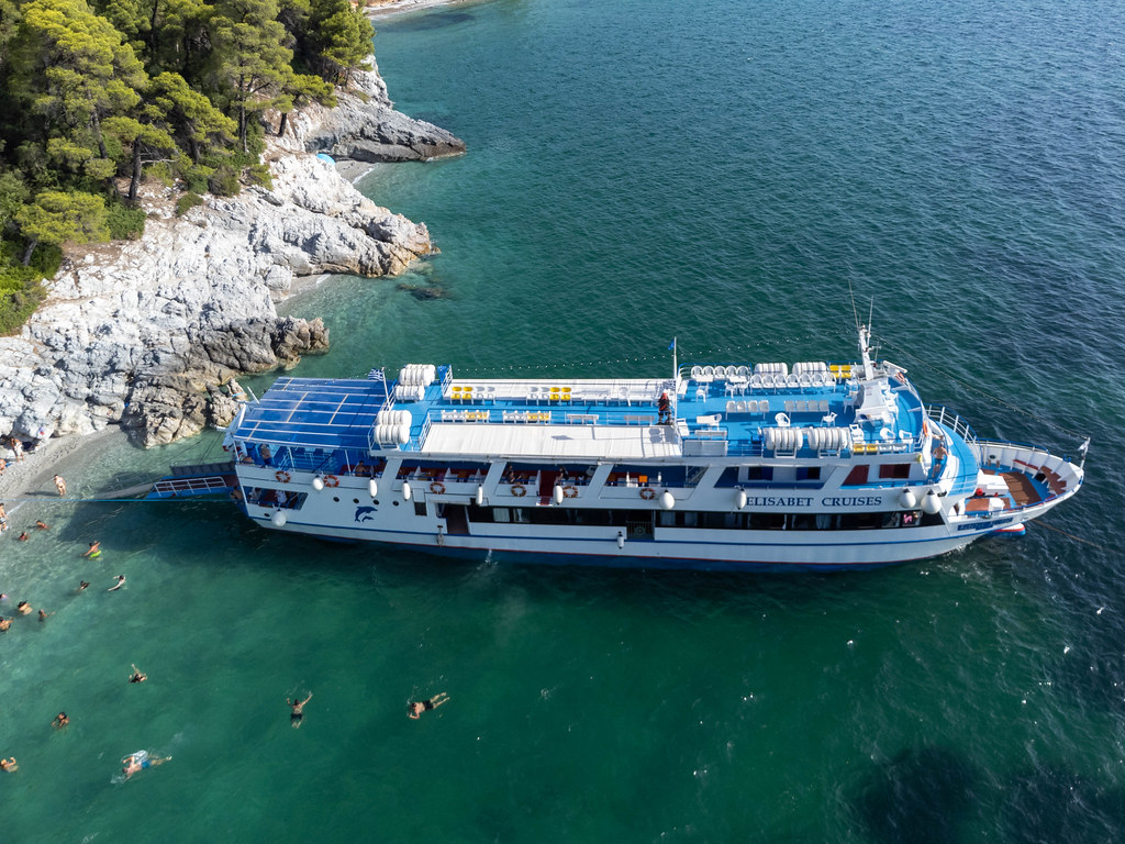 Cruise ship makes a stop at Kastani beach, famous thanks to movie Mamma Mia!, on Skopelos