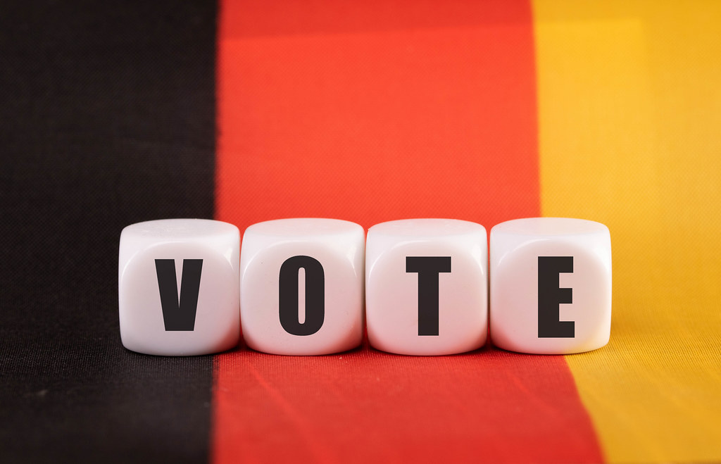 Cubes with Vote text on German flag