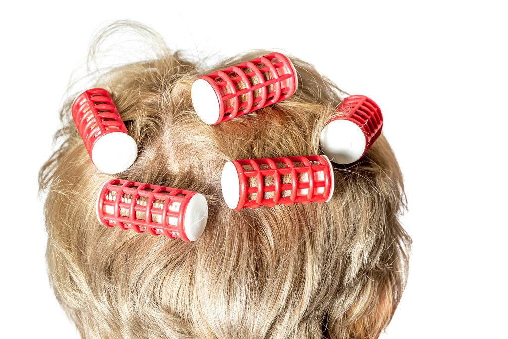 Curling woman hair with thermo curlers