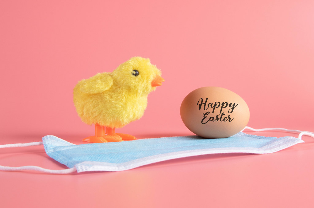 Cute little chicken, medical face mask and egg with Happy Easter text