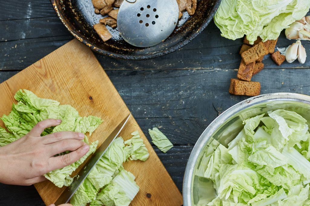 Cutting savoy cabbage for salad