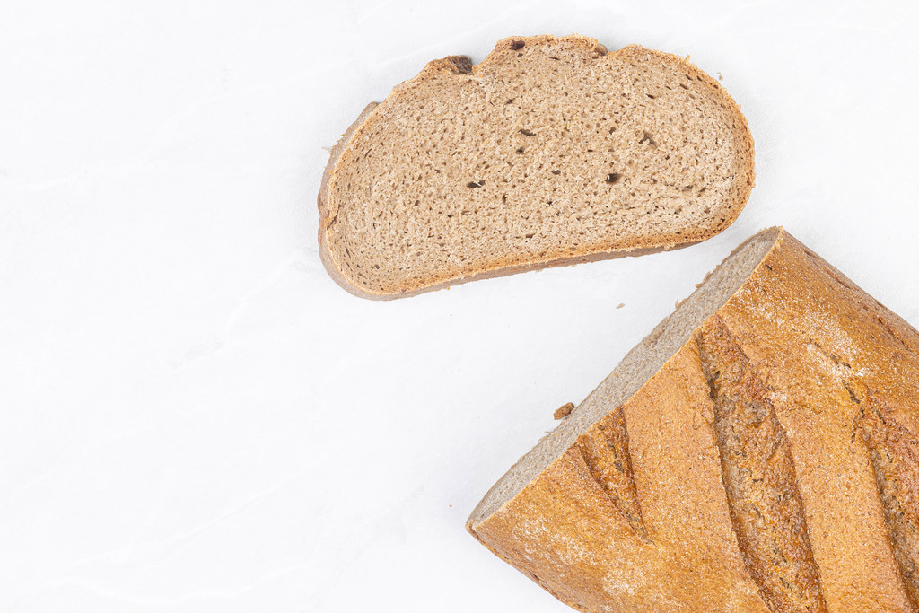 Dark bread with unleavened dough on the table with copy space