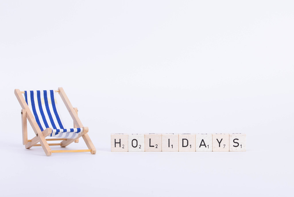 Deck chair with Holidays text on white background