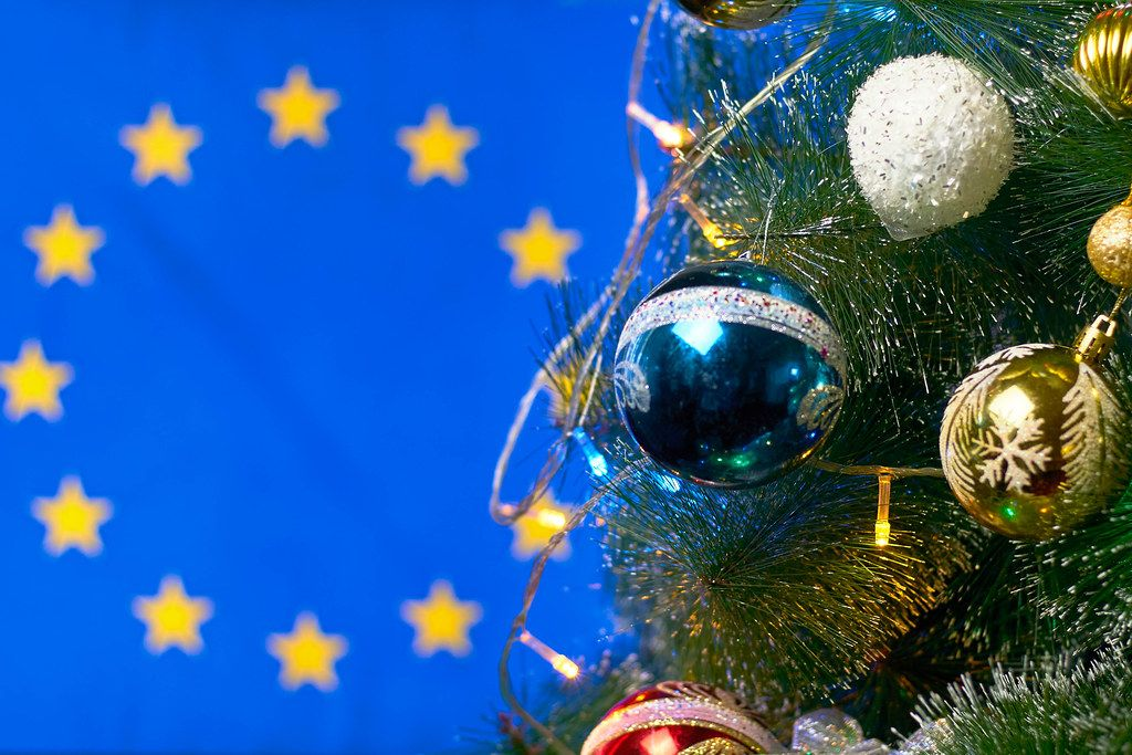 Decorated Christmas tree against the European Union flag