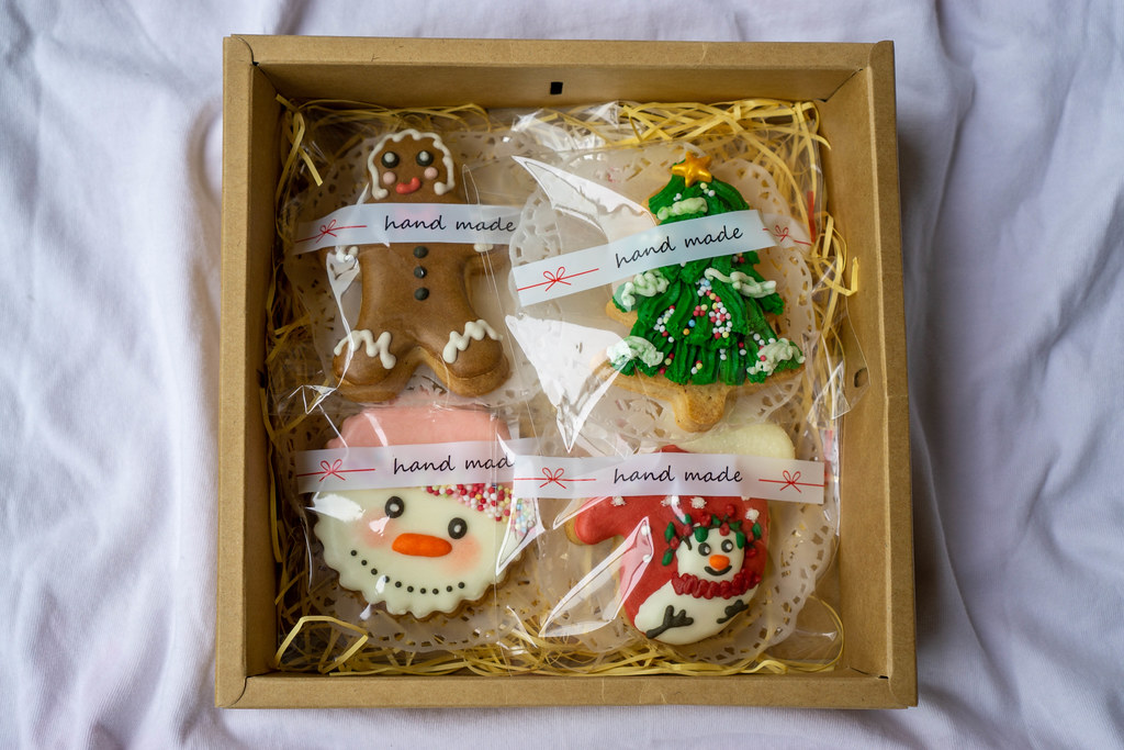 Decorated Gingerbread Cookies packed in Plastic Bags in a Paper Box as a Christmas Gift